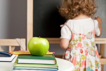 Schoolchild in class writing on blackboard Stock Photo - 9767448