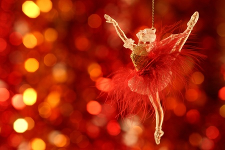 Christmas-tree decorations against blurred red background Stock Photo