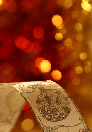 Christmas ribbon against blurred background photo