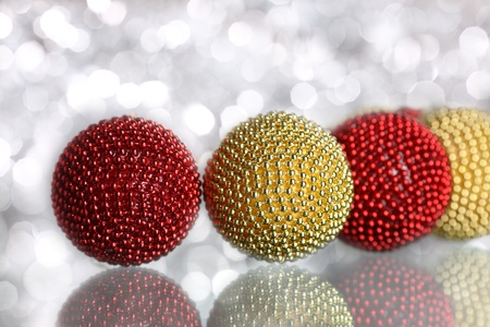Colorful Christmas balls on silver background photo