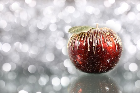 Christmas apple on silver blurred background photo
