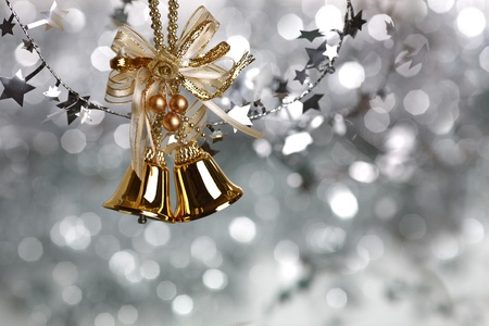 silver bells: Christmas tree decoration on silver light background