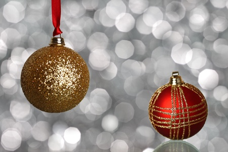 Red and gold Christmas balls on silver blurred background photo