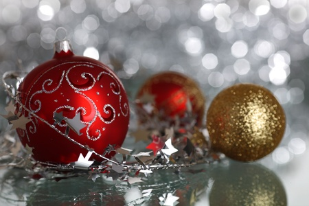 Christmas tree decorations on silver light background photo