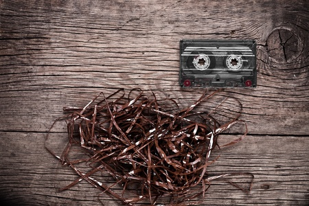 Retro cassette on wooden texture. Abstract background photo