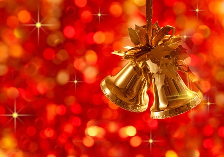 Gold Christmas tree decorations on lights background photo