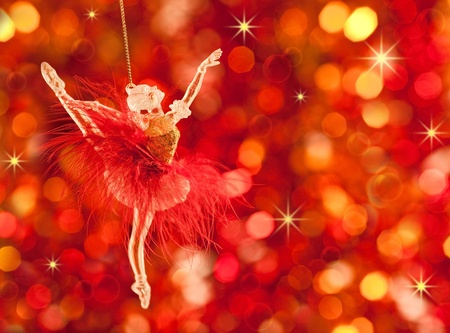 Christmas tree decoration on lights red background Stock Photo