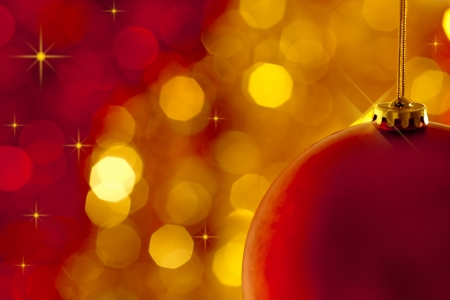 Christmas tree decoration on lights red and gold background Stock Photo