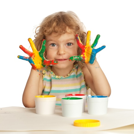 Happy child with finger paint isolated on white photo