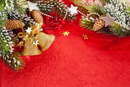 fir cones: Christmas border from branch and decorations on red paper background