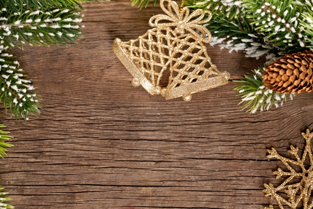 snow cone: Christmas border from branch and bells on wooden background
