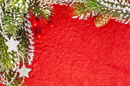 Christmas frame from branch and decorations on old paper background photo