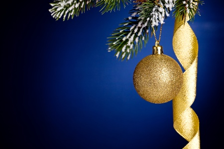 Border from Christmas tree branch and decorations on dark blue background Stock Photo - 10656750