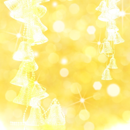 Silhouette of bells on abstract lights background. Christmas frame photo