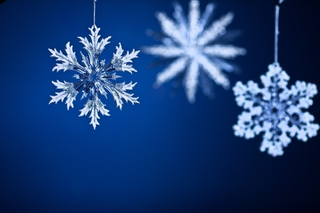 Beautiful snowflakes on blue gradient background. Christmas concept photo