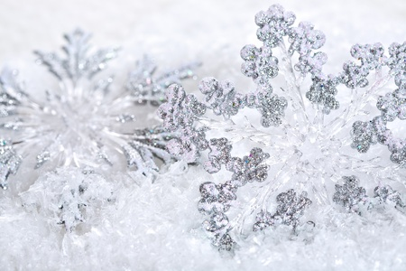 backround: Abstract Christmas background with snowflakes. Shallow depth of field, blue tinted