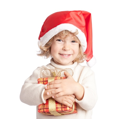 Happy child with Christmas gift isolated on white background Stock Photo - 11235465