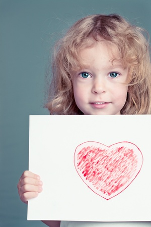 Beautiful girl with drawn heart photo