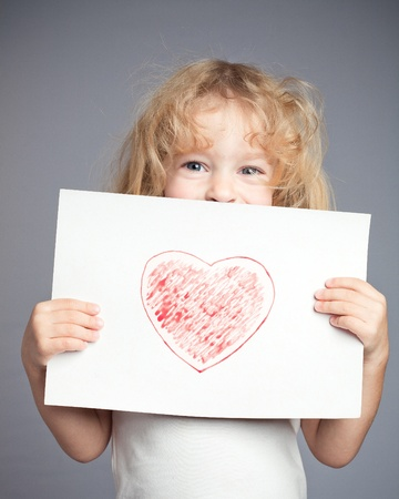 hands holding heart: Drawn heart in baby hands. Valentine`s day concept