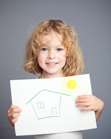 child finger: Drawn sun and house in baby hands. Spring concept