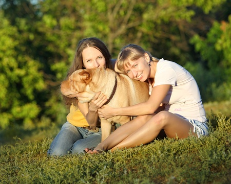 sharpei: Two girls with dog in summer Stock Photo