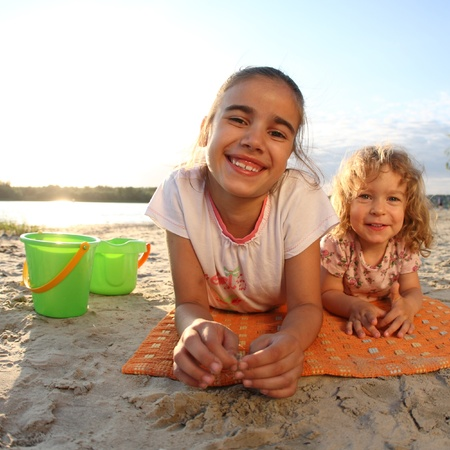 Happy children having fun on beach photo