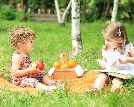 Children having picnic in summer park photo