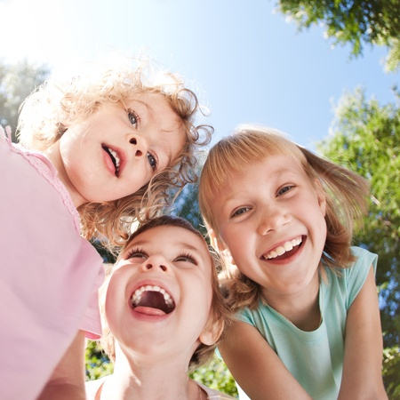 Happy children having fun in spring photo