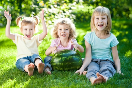 Group of happy children playing outdoors in spring park Stock Photo - 12235382