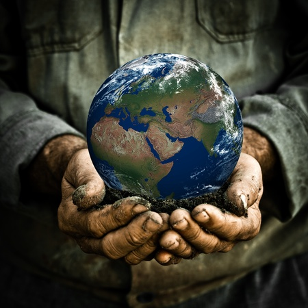 ball of water: Old man hand holding Earth  Symbol of spring and ecology concept