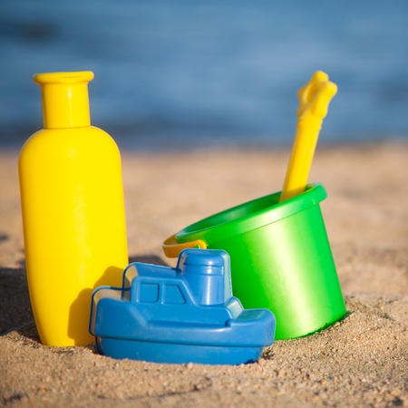 for children toys: Children s toys for sand and sunblock lotion at the beach