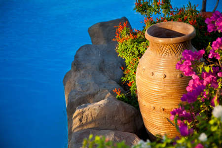 Decorative bed with amphora  Summer vacations background photo