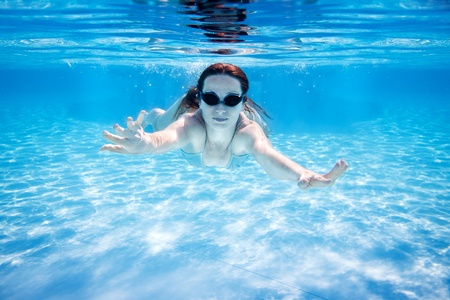 Woman swimming underwater in pool  Summer vacations Stock Photo - 12580814