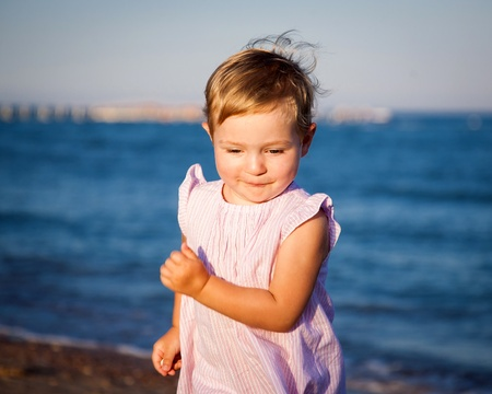 Funny child running at the beach Stock Photo - 12925304