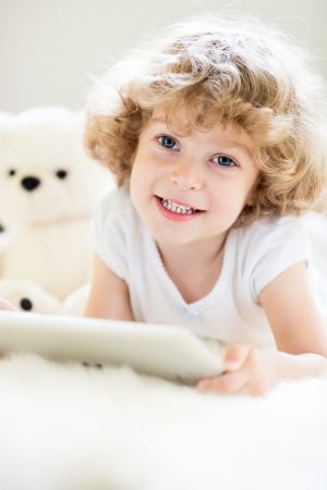 Portrait of child using tablet computer photo