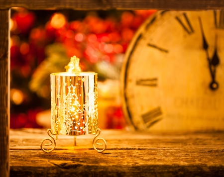 Burning Christmas candle at midnight. New year concept photo