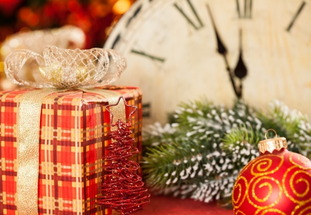 Christmas decorations against vintage clock at midnight. New year concept photo