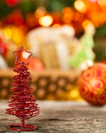 beautify: Little handmade Christmas tree against lights blurred background Stock Photo