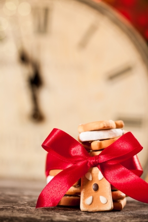Christmas cookies with red bow against old clock photo