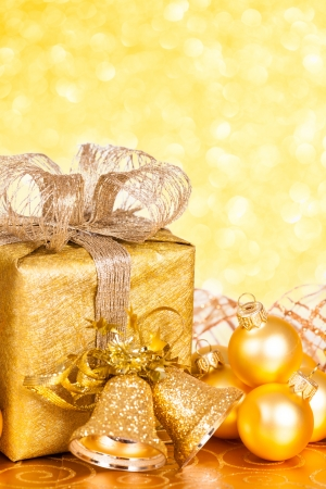 Golden Christmas tree decorations against lights background Stock Photo - 14931520