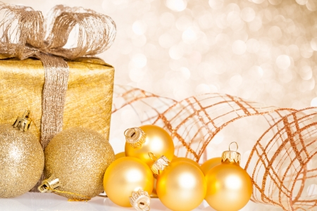 Golden Christmas tree decorations against lights background photo
