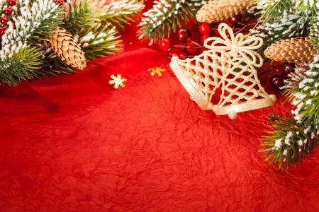 Border from Christmas tree decoration on red paper photo