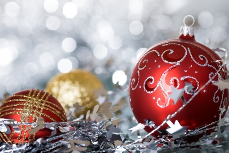 Christmas tree decorations against silver lights background photo