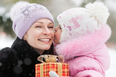 Happy family with Christmas gift box in winter park Stock Photo - 15042243