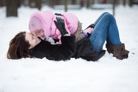 snow woman: Happy family having fun in winter park Stock Photo