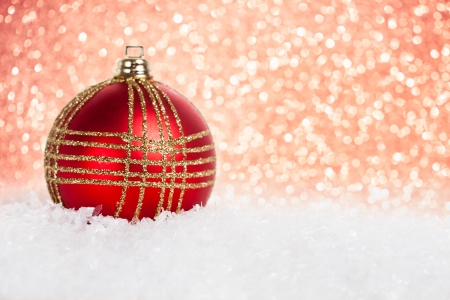 Christmas tree decoration in snow against lights background photo