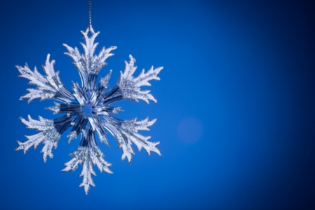 Christmas tree decoration on blue  Abstract background photo