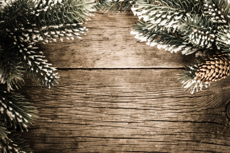 christmas tree background: Vintage frame from branch of Christmas tree on old wood