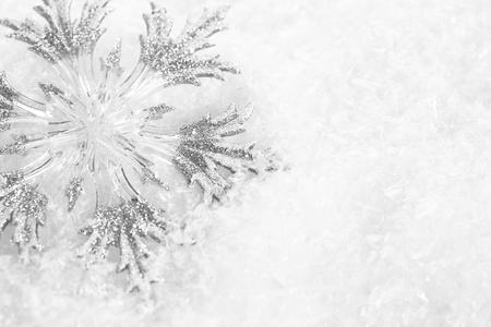 Christmas tree decoration on snow  Abstract background, shallow depth of fields photo