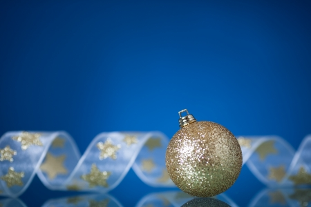 Christmas tree decorations on blue mirror photo